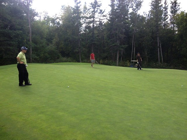 John, Russ and Doug on the green at 7.