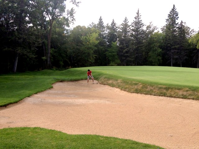 Russ blasts out of the sand trap on 6.